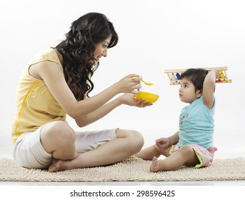 Mother trying to feed her child