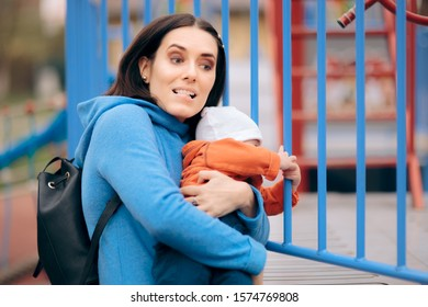 Mother Trying to Take Home Baby from Playground. Naughty daughter acting out in the park