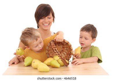 mother and two boys with fresh pears isolated on white