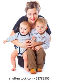 Mother and two boys. Isolated on white background