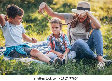 Mother with two children camping