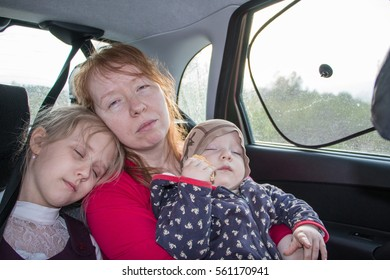 Mother and two children in the car