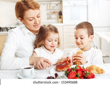 Mother and two children having breakfast together