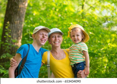 Mother with two children outdoors