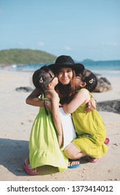 Mother and two daughters are happy during the summer time