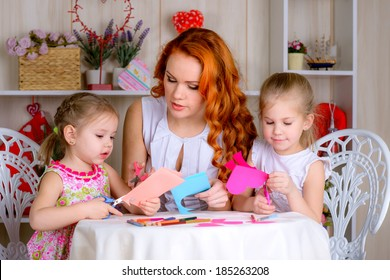 Mother with two daughters making card