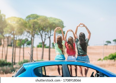 Mother and two little children summer car vacation