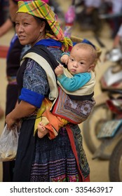 Mother vietnamese with a baby on her back, Mu Cang Chai Yen Bai Province, Vietnam.