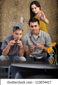 Mother vying for attention from husband and son playing video games