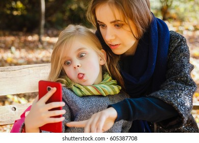 Mother walking with her daughter outdoors in the autumn