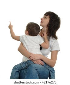 Mother watches where her little son is pointing out by finger, isolated on white