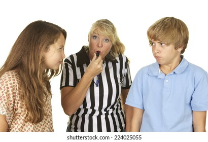 Mother wearing a referee shirt and blowing a whistle between her two arguing children.  shot in the studio on a white background.