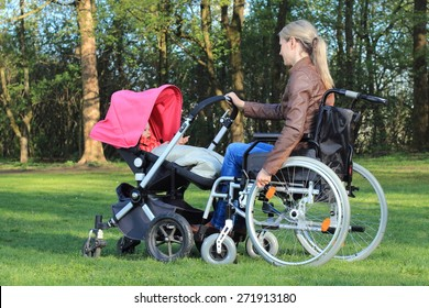 A Mother in wheelchair pushing a pram with baby