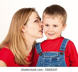 Mother whisper in son's ear