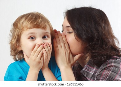 Mother whispers secret to her little son