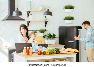 Mother working from home, cooking, talking phone, taking care of her child. Mommy bsinesswoman. Hungry father searching food in empty fridge Multitasking and husework concept.