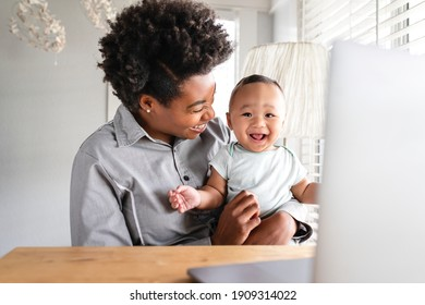 Mother working from home remotely with kid