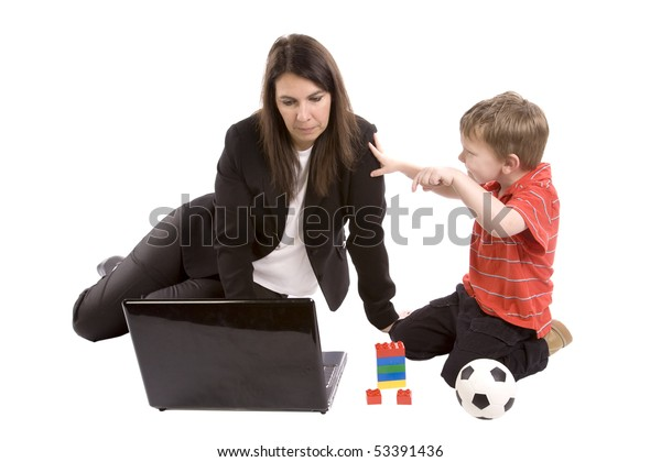 A mother working on her computer while the son tries to play.