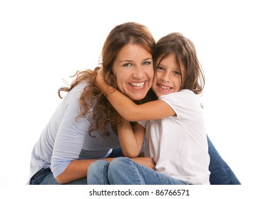 Mother and young daughter in an affectionate pose on a white background.