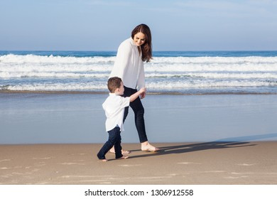 mother and young son on the beach