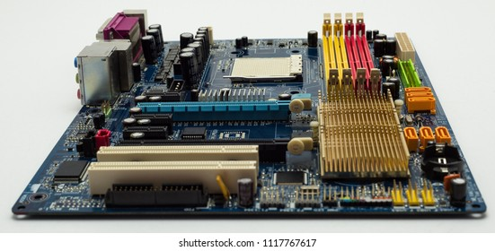 Motherboard with visible PCI express connector slot, heat sink, memory slot, cpu socket in blue.