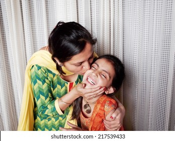 Motherhood- loving her daughter.