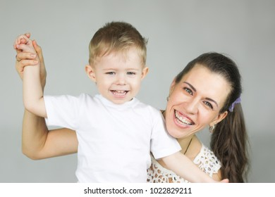 motherhood. Mother and son. on a white background