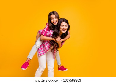 Motherhood parenthood concept. Portrait of charming cute mom little kid have free time funky walk stroll feel satisfied playful carefree dressed colorful stylish outfit isolated yellow background