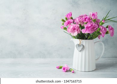 Mother's day background with flowers and heart shape on wooden table