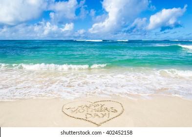 Mother's day background on the sandy beach near ocean