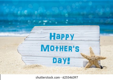 Mother's day background with starfish on the sandy beach near the ocean