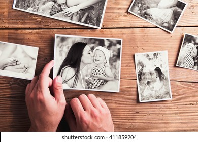 Mothers day composition. Black-and-white pictures, wooden backgr