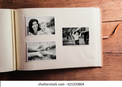 Mothers day composition. Photo album, black-and-white pictures. Mother with child. Mothers day celebration. Happy mother and son. Concept with family photos.