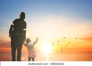 Mother's Day concept: mom and child on sunset background