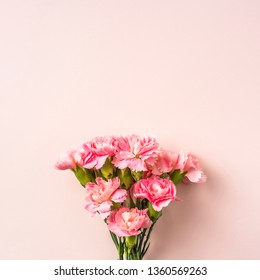 mothers day design concept - top view of a bunch of carnation with comic dialog frame decoration on pink background for mothers day, wedding and valentines day with copy space for mock up