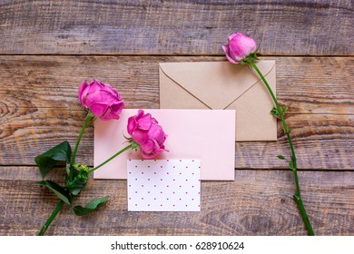 Mother's day gift with peony flowers, envelope and card top view mockup