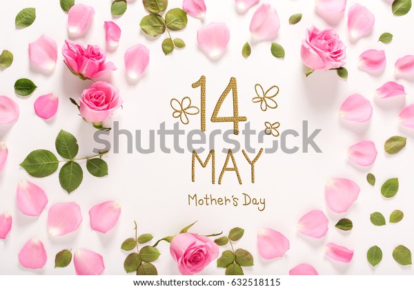 Mother's Day message with roses and leaves top view flat lay