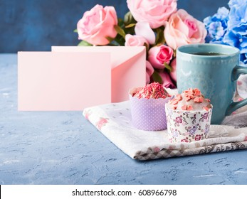 Mother's day Valentine concept muffin with frosting and hearts cup of tea