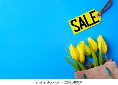 mothers day, valentine, women day, spring holidays seasonal sale, shopping, love. special offer, discount symbol. price tag and yellow tulips on blue background, shopping banner template