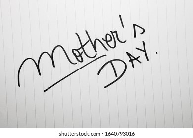 Mother`s day writing love text for mother on paper. Label tag with lovely message for mother`s day.