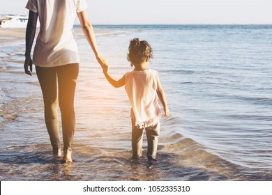 Mothers  hand lead his  little girl  in the beach nature outdoor, trust family concept