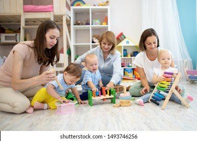 Mothers with their babies play with developmental toys in daycare centre