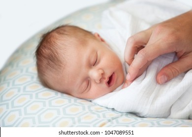 A mother's touch is magical to a newborn baby infant
