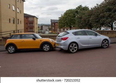 Motherwell, Scotland - 11 September 2017: Wrong Parallel Car Parking, Silver Car was parked without securing handbrake on hill which resulted on car sliding backward and stopped on yellow car behind