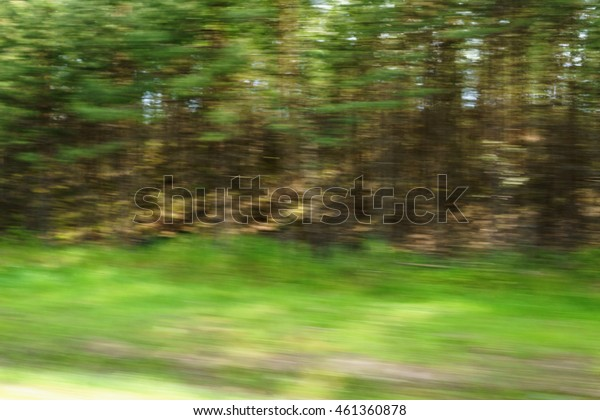 motion blur background of green countryside