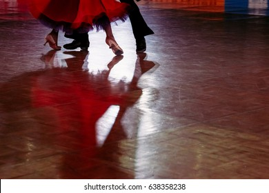 Motion blur of couple dancers in a dance spotlight on the floor, during Grand Slam Standard dance.