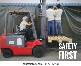motion blur effect. Employees are installing curtains without safety equipment.  'SAFETY FIRST' text apply.