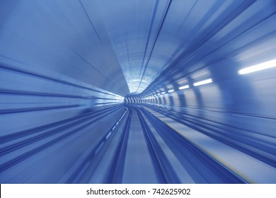 Motion blur / effect of Malaysia MRT (Mass Rapid Transit) train moving fast inside tunnel. MRT is a transportation for future generation.