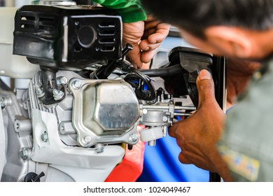 Motion blur image of agriculture hand assemble gasoline engine water pump
