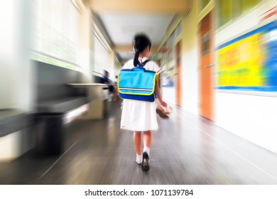 Motion and blur image of child walking into the classroom.